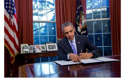 President Obama at his desk in the White House