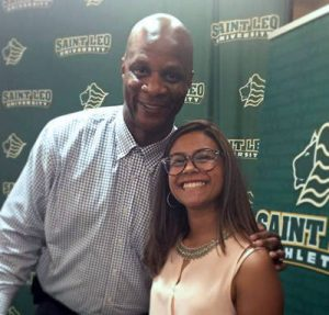 College hopeful and high school athlete, Sabrina Ramos, posing with Darryl for a photo